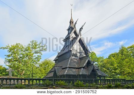 Fantoft Stave Church And Blue Sky With Clouds In Bergen, Norway