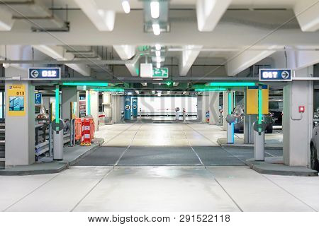Barrier At Entrance And Exit Of A Car Parking Garage. Barrier In A Car Park. Exit From Underground P