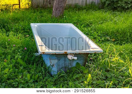 Cast-iron Bath In The Middle Of The Lawn In The Garden