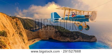 Child girl pilot aviator in airplane flying over beach in summer at sunset. The travel by air concept.