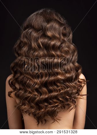 poster of Girl with long, curly hair, rear view. Hair texture, close-up. Long brown curly hair - back view.