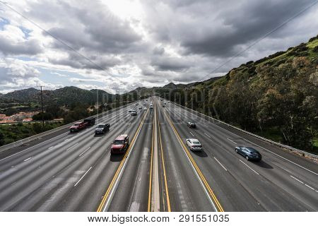 Los Angeles, California, USA - March 21, 2019:  Spring storm clouds over the 118 freeway below the Santa Susana Pass in the San Fernando Valley.