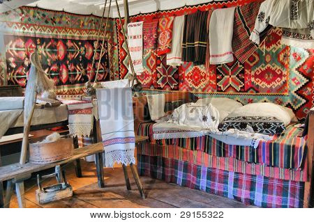 HDR.Ukrainian historical peasant dwelling interior with various home articles. (museum)