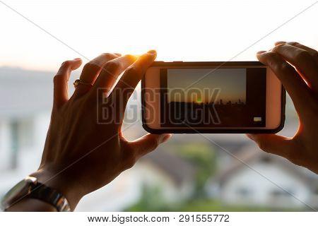 Close Up Woman Hand Holding Smartphone Taking Photo Sunset City. Beautiful Scene On Screen. Girl Usi