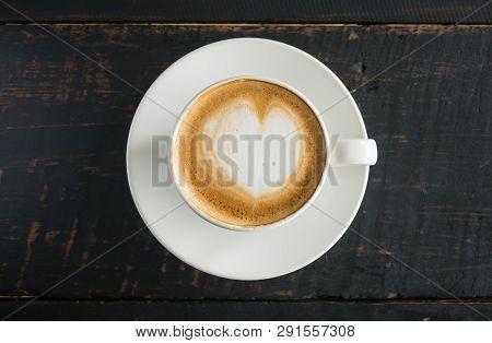 Heart Shape Froth Milk Latte Art In White Coffee Cup On Black Wood Table. Heart Shape Froth Milk Lat