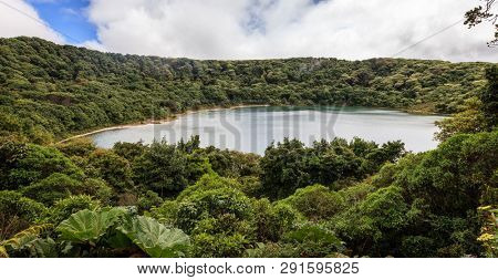 scenic view of a lake in the smaller crater of Poas Volacano in Costa Rica