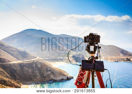 Professional Camera Taking Picture Film Video Of Seascape With Mountains. Greece Peloponnese Mani Pe