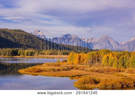 A Scenic Reflection Landscape In The Tetons Of Wyoming In Autumn