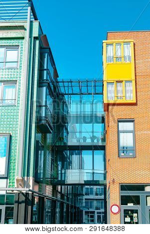 Vlissingen, The Netherlands - April 2015: Modern Architecture. Glass Pedestrian Bridge Connecting Tw