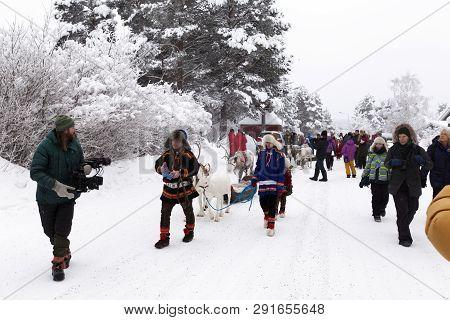 Jokkmokk, Sweden On February 08. View Of The Parade Through Jokkmokk Community With Reindeer, Tradit