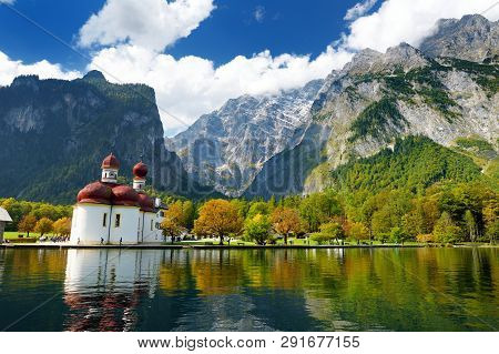 St. Bartholomew Church On Konigssee, Known As Germany's Deepest And Cleanest Lake, Located In The Ex