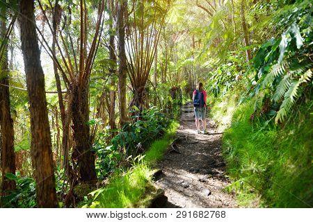 Tourist Hiking On Kilauea Iki Trail In Volcanoes National Park In Big Island Of Hawaii. Trail Leads
