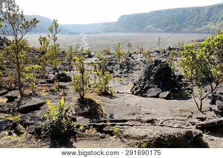 Stunning View Of The Kilauea Iki Volcano Crater Surface With Crumbling Lava Rock In Volcanoes Nation
