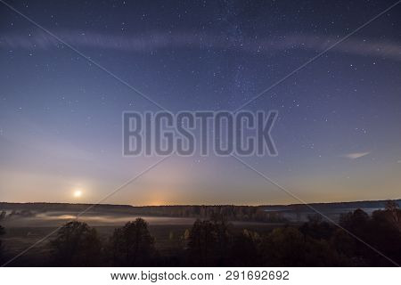 Beautiful Nightscape And Starlit Sky By The River