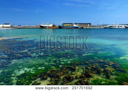 Blue Waters In Harbor Of Kilronan Of Inishmore, The Largest Of The Aran Islands In Galway Bay. Famou
