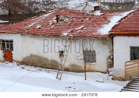 A Ladder And A Ruined House