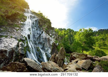 Majestic Water Cascade Of Powerscourt Waterfall, The Highest Waterfall In Ireland. Famous Tourist At