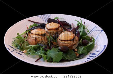 Warm Chevre Chaud Goat Cheese Baked On Rustic Bread With Green Salad And Olives. Traditional French