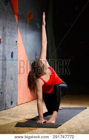 Young Active Woman Practising Yoga in the Climbing Gym. Healthy and Active Lifestyle.