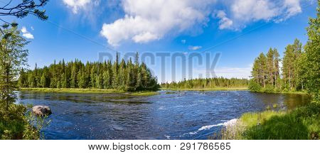 Panoramic view of a bend of a river with rapids in boreal forest on a bright summer day, Republic of Karelia, Northwestern Russia