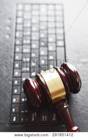 Wooden Judge Gavel On Keyboard Laptop Computer. Concept Of Online Auction, Legal System, Law And Tec