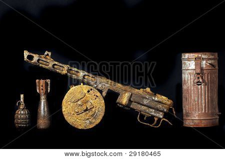 Military archeology.World War II Soviet machine-gun remains and German cannister for gas mask Found with metal detector