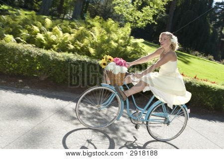 Retro Girl On Bike