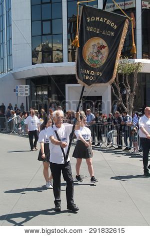 Limassol, Cyprus, March 25th, 2019: Veteran Standard Bearer Marching Along The Archbishop Makarios I