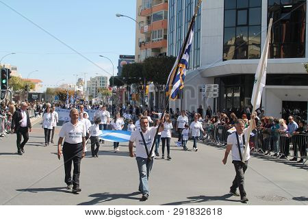 Limassol, Cyprus, March 25th, 2019: Flag Bearers Marching Along The Archbishop Makarios Iii Avenue D