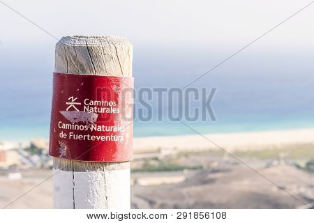 Post On The Fuerteventura Mountains Informing Hikers About The Trail.