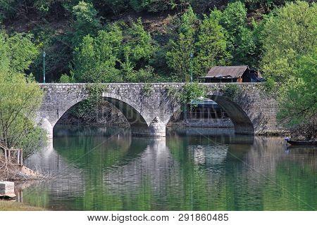 Double Arch Stone Bridge At Rijeka Crnojevica In Montenegro