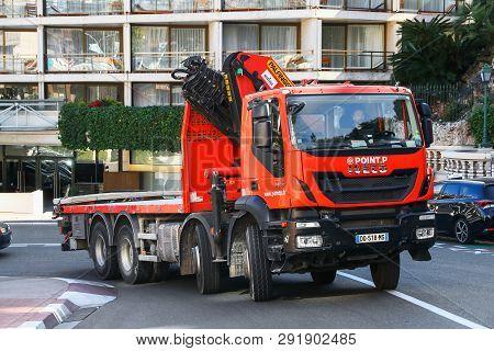 Monte-carlo, Monaco - March 12, 2019: Red Truck Iveco Trakker In The City Street.