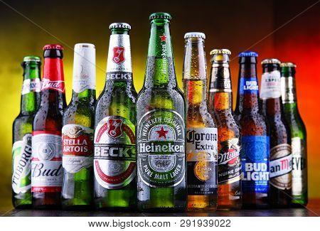 Poznan, Pol - Mar 15, 2019: Bottles Of Famous Global Beer Brands Including Heineken, Becks, Bud, Mil