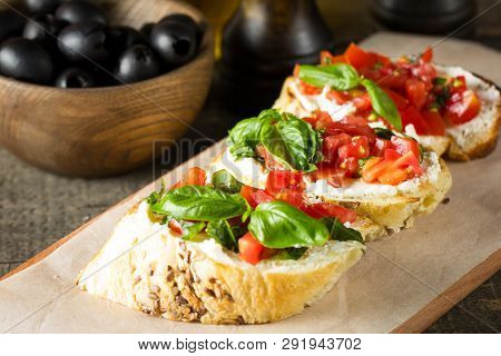 Tomato And Cheese Fresh Made Bruschetta. Italian Tapas, Antipasti With Vegetables, Herbs And Oil On