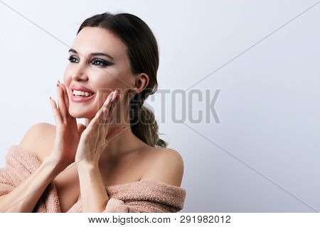 Happy Beautiful Young Woman With Clean Fresh Skin Touch Her Face, Close-up.