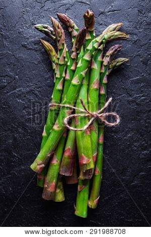 Green asparagus sprout on black board top view flat lay