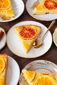 Fruity sponge cake with fresh candied oranges poster