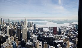 Panoramic Aerial Elevated View Up Above Chicago Looking Over Lake Michigan Covered In Ice During The
