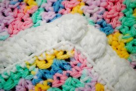 Close-up Of A Colorful Handmade Baby Blanket