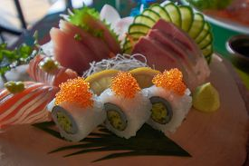 A set of 3 kinds of fish in a sashimi menu.
