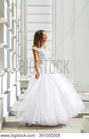Young beautiful schoolgirl in ballroom prom dress