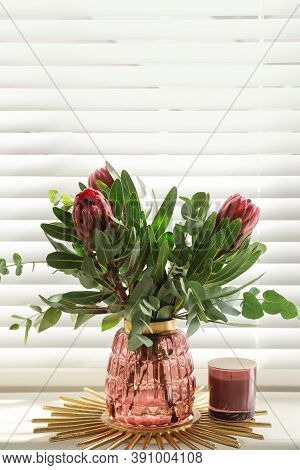 Vase With Bouquet Of Beautiful Protea Flowers On Window Sill Indoors