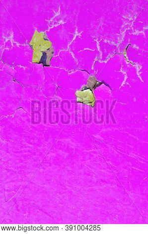 Texture background of peeling paint - pink peeling paint on the wooden texture surface,closeup of peeling paint texture on the old wooden texture background.Grunge texture surface with pink peeling paint