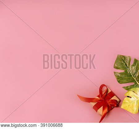 Banner Gift Box On Pink Background With Monstera Leaves Holiday Concept Top View Copy Space For Text