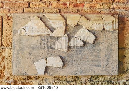 Board With Latin Inscriptions In Archaeological Site Anthony Terms,. The Ruins Antique Times Of The