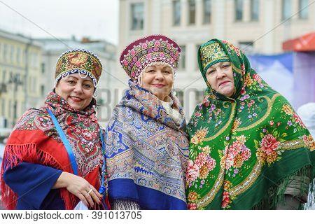 Saint Petersburg, Russia-november 4, 2019:  Three Happy And Smiling Senior Women Dressed In Russian