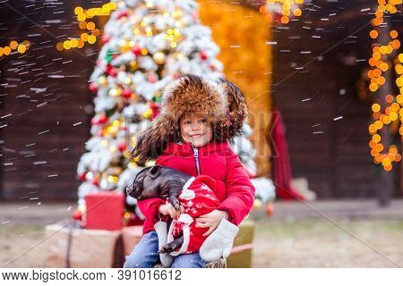Portrait Of Young Pretty Girl In Traditional Russian Fur Cap With Ear Flaps And Red Winter Jacket Po