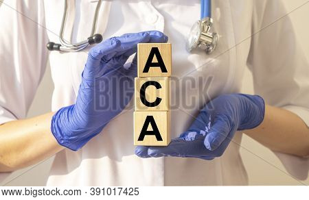 Aca Or Affordable Care Act Text Acronym On Cube Blocks In Doctor Hands In Gloves