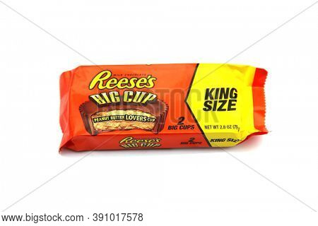 LAKE FOREST, CALIFORNIA - October 22, 2020: Reese's Peanut Butter Cup KING SIZE BIG CUP  candy. Reese's was first introduced in 1928 and is now part of the Hershey Company. Isolated on white.