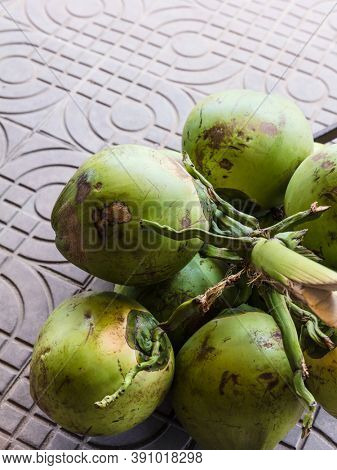 green coconuts in the street market